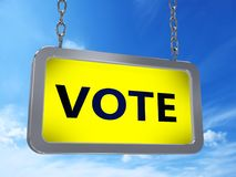 Vote on billboard. Vote on yellow light box billboard on blue sky background Stock Images