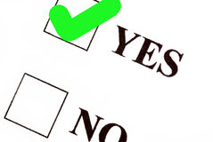 Vote yes. Yes and no boxes, yes voted Stock Image