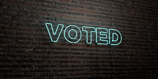 VOTED -Realistic Neon Sign on Brick Wall background - 3D rendered royalty free stock image Royalty Free Stock Photo