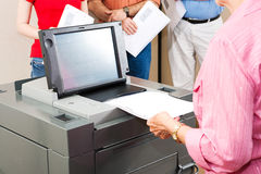 Voter Casts Ballot. Closeup of a senior women casting her ballot on a new electronic voting machine Royalty Free Stock Image