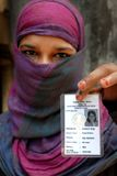 Voter Identity Card. A woman showing his voter ID card at a polling station in Kolkata during elections Stock Photo