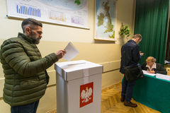 Voter at the polling station during polish parliamentary elections to both the Sejm and Senate. Stock Image