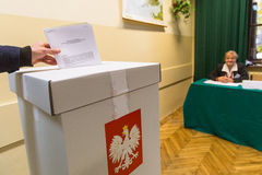 Voter at the polling station during polish parliamentary elections to both the Sejm and Senate. Stock Photo
