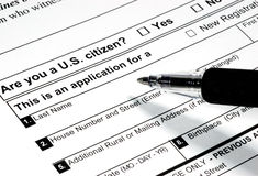 Voter Registration. Pen writing on a voter registration form stock image