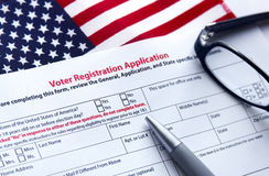 Voter Registration Application. With flag of United States of America Royalty Free Stock Photo