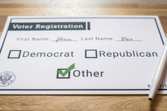 Voter registration card with third party selected - Close Up. A close up photo of a faux voter registration form signifying that a person is joining a third Royalty Free Stock Photography
