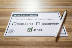 Voter registration card with third party selected. Photo of a faux voter registration form signifying that a person is joining a third party or green party Stock Image