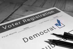 Voter Registration Form - Democrat. A mock voter registration form indicating a person has signed up as a democratic voter Stock Photos