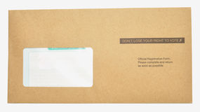 Voter Registration Letter. A voter registration form in a brown envelope with don't loose your right to vote printed on it, isolated on a white background Royalty Free Stock Photography