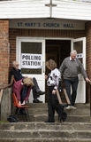 Voters leaving a Polling Station. Voters at the Polling Station within St Pauls Church Hall in Kings Worthy Winchester Hampshire England UK Stock Photo