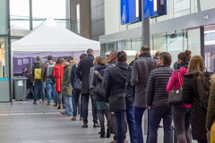Voters lining up to vote in train station polling booth Stock Photography