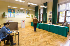 Voters at the polling station during polish parliamentary elections to both the Sejm and Senate. Royalty Free Stock Photos