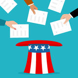 Voters putting election bulletins in the uncle sam hat Royalty Free Stock Image