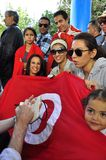 Voters with tunisian red flag waiting to  vote. Speaking to reporter , very happy and proud Stock Image