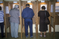 Voters and voting booths. In a polling place, CA Stock Photography