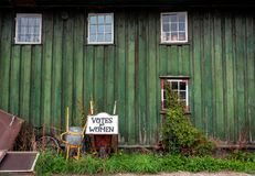 Votes for Women, sign near traditional village house of Christiania Freetown with wooden walls stock photos