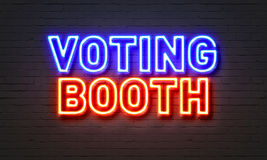 Voting booth neon sign on brick wall background. Stock Photography