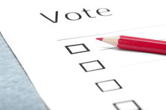 Voting bulletin. With red pencil on a table Royalty Free Stock Image