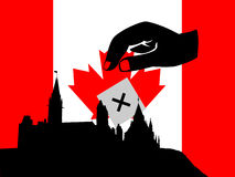 Voting canadian parliament. Hand voting in Canadian election with flag and parliament Royalty Free Stock Photos