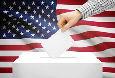 Voting concept - Ballot box with national flag on background - United States Stock Images