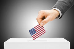 Voting concept - Man inserting flag into ballot box - United States. Voting concept - Male inserting flag into ballot box - United States Royalty Free Stock Photography