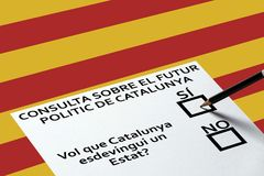 Bulletin for voting on the Catalonia flag background. Democracy Freedom Independence Concept. Voting in elections or referendum, ballot for voting on the royalty free stock images