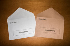 Voting envelopes for Senate and Congress in Spanish general election day, laid on wooden surface Royalty Free Stock Image