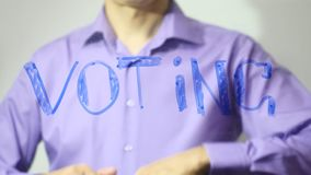 Voting inscription businessman writes on glass 4k video stock video