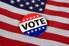 Voting pin on American flag Royalty Free Stock Photo
