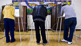 Voting at polling station  Stock Photos