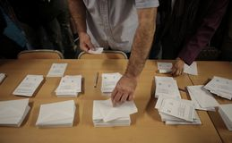 Voting in a Polling station during the referendum day in barcelona. People choose their vote on a poll station during the banned pro independence referendum day Stock Photo