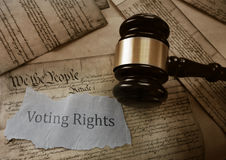 Voting Rights concept. Voting Rights news headline on a copy of the US Constitution with gavel royalty free stock image