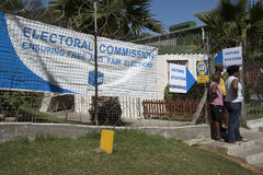 Voting station in African township. IMIZAMO YETHU TOWNSHIP WESTERN CAPE SOUTH AFRICA - APRIL 2016 - Voting station with woman standing outside in this township stock photo