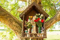 Votive aedicula on a tree Stock Image