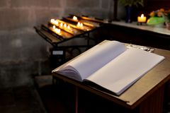 votive altar in church with emtpy guestbook stock images