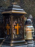 Votive candle on tombstone Stock Photos