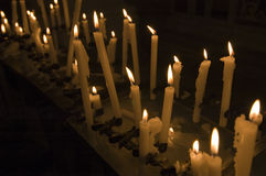 Votive candles. Burning in a catholic church stock photo