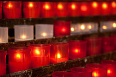Votive candles. Burning candles for promise payment in catholic church Royalty Free Stock Photos