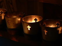 Votive candles. Burning in a darkened cathedral stock photo