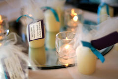 Votive Candles. An arrangement of votive candles on a mirror as a centerpiece decoration for a wedding reception stock photo