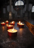 Votive candles. On an ancient holder. Church interior royalty free stock image
