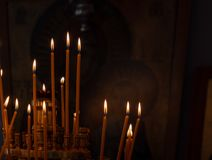 Votive candles alight in Church. Votive candles alight in Greek Orthodox Church stock images
