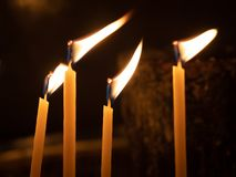 Votive candles alight in Church. Votive candles alight in Greek Orthodox Church stock photography