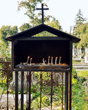 Votive candles in Bellu Cemetery, Bucharest, Romania. Votice candles lit for the souls of the dead in the Catholic section of Bellu Cemetery, Bucharest, Romania Royalty Free Stock Image