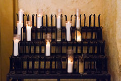 Votive candles. Burn in a quiet church alcove in San Fernando cathedral in San Antonio, Texas royalty free stock photography