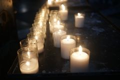 Votive candles in church. Votive candles burning in church royalty free stock image