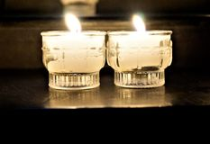 Votive candles in church Stock Images