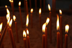 Votive candles in the church Stock Photography