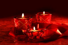Votive candles on dark background Royalty Free Stock Photos