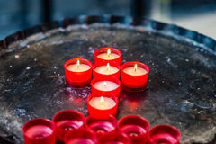 Votive candles forming the Cross. Votive candles form the symbol of the Cross stock images